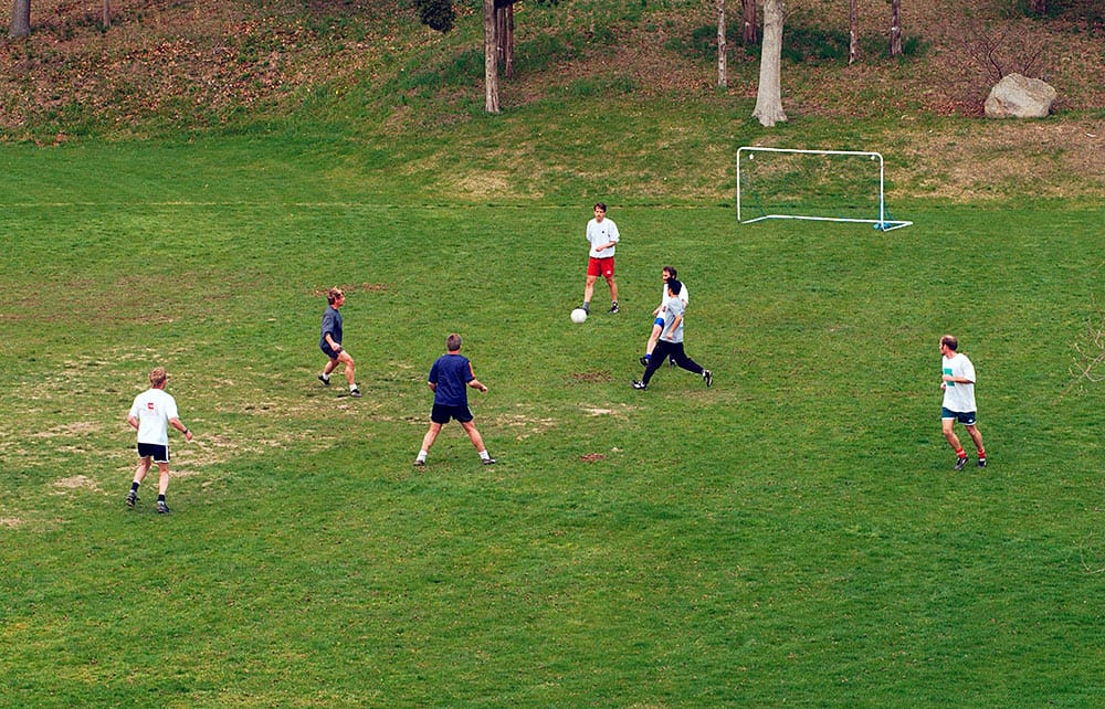 WHOI employees and students play a lunchtime soccer match. (Woods Hole Oceanographic Institution)