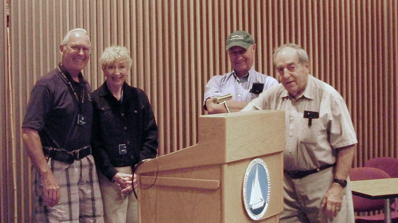 Peanut Butter Club participants gather at the Redfield Auditorium podium. Photo by Joanne Tromp, Woods Hole Oceanographic Institution.