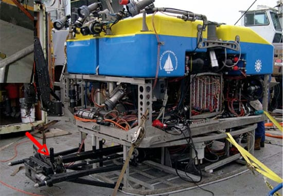 The National Deep Submergence Facility (NDSF) ROV Jason2 fitted with the MBARI drill system (red arrow) in 2003 for work at the Endeavour hydrothermal vent field. (Photo by D. Kelley)
