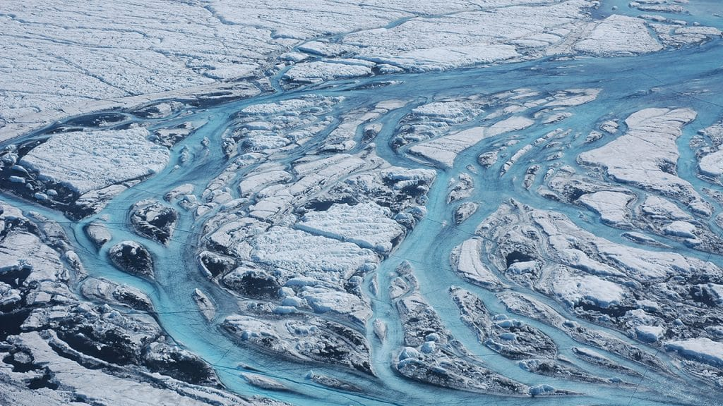 Rivers flow on the ice sheets of Greenland, one of the fastest changing areas of the world due to climate change. (Photo by Sara Das, Woods Hole Oceanographic Institution)