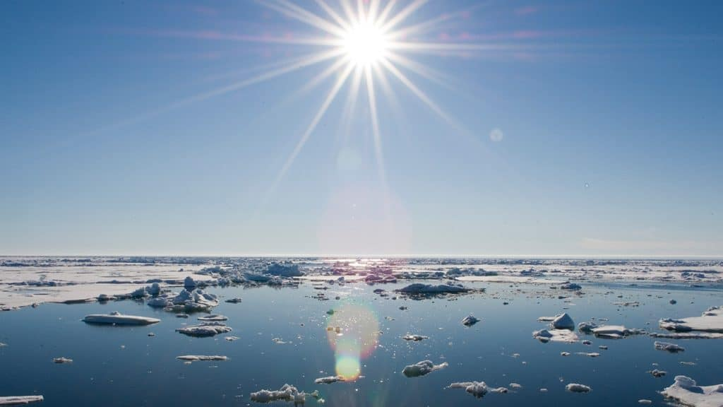 Sun over the Chukchi Sea. The planet's far northern and southern latitudes are projected to experience the greatest change under increasing global temperatures—and in many cases they already are. (Photo by Chris Linder, Woods Hole Oceanographic Institution)