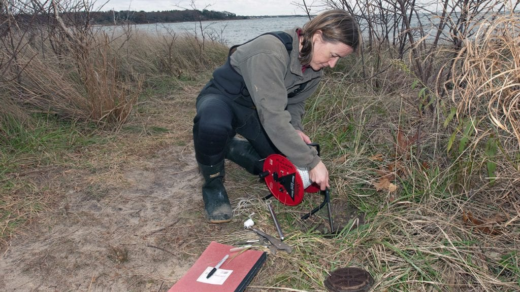 A WHOI researcher collects data about groundwater discharge into Waquoit Bay, Mass. (Photo by Tom Kleindinst, Woods Hole Oceanographic Institution)