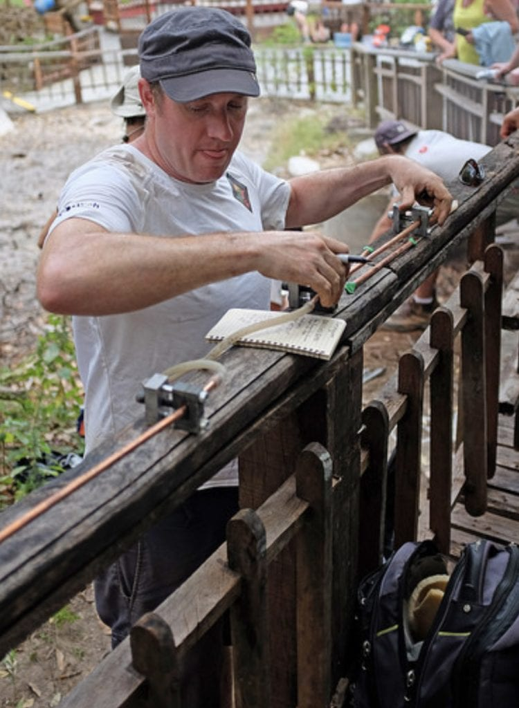 Peter Barry sets up gas sampling equipment at a hot spring in Costa Rica. Credit: Katie Pratt