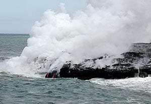 Ocean entry of the Pu'u Oo flow, Kilauea volcano Hawaii in June, 2001. Note the two small rivulets of lava cascading down the face of the flow just above the water line in the center-left of the frame. Distance across the photo is about 20 meters.