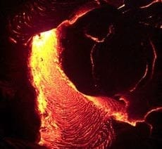 Lava flowing at night during from the Pu'u Oo eruption on Kilauea volcano Hawaii in April, 2000. Scale across photo is about 1 meter.