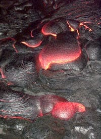 Pahoehoe toes forming in the active part of the Pu'u Oo flow, Kilauea volcano Hawaii in April, 2000. Scale across photo is about 2 meters.