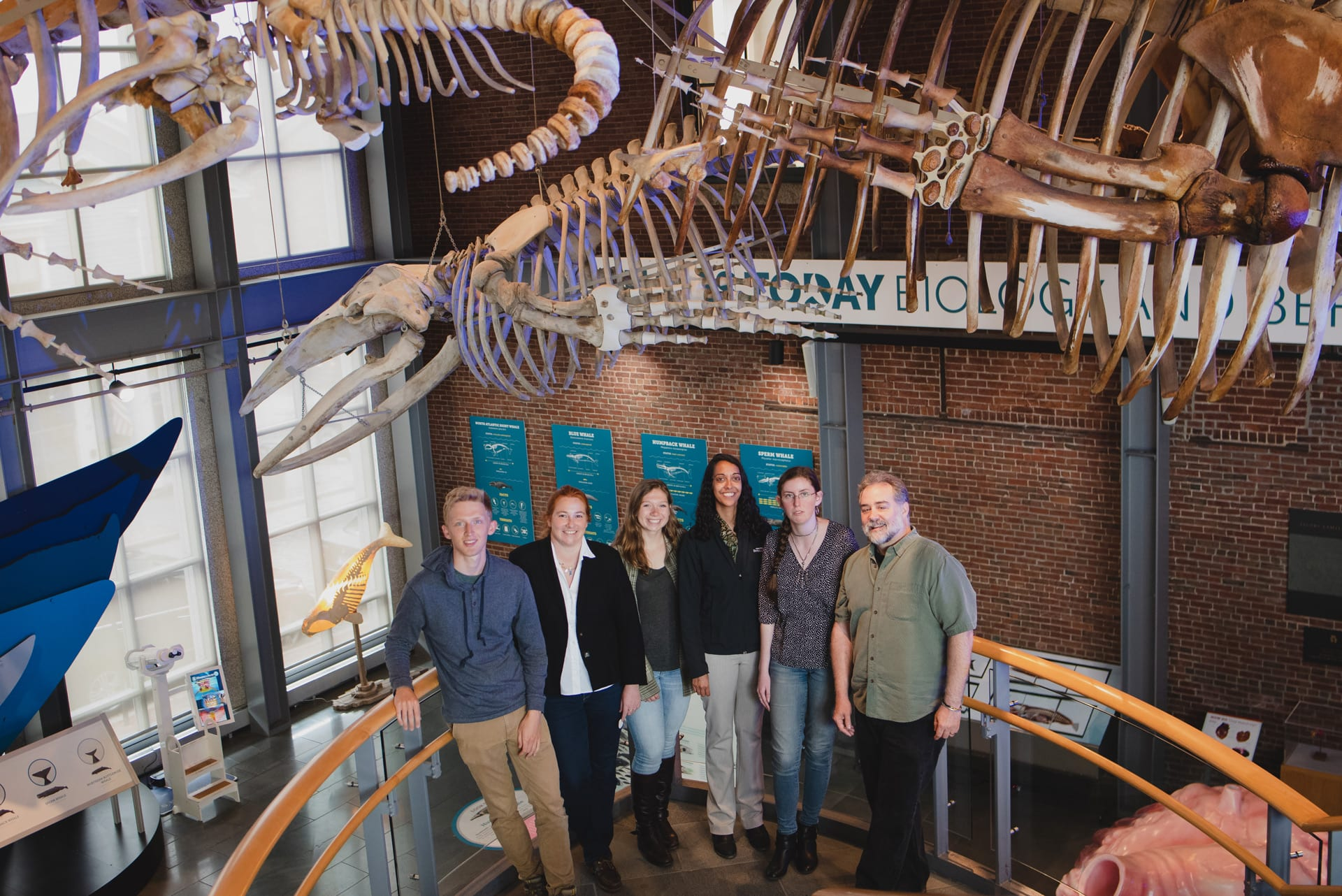 "The research team on a ""field trip"" to the New Bedford Whaling Museum, which holds several hundred whaling logbooks in its archives. From left to right: Justin Buchli, Caroline Ummenhofer, Cali Pfleger, Sujata Murty, Abigail Field, and Timothy Walker. (Photo courtesy of New Bedford Whaling Museum)"