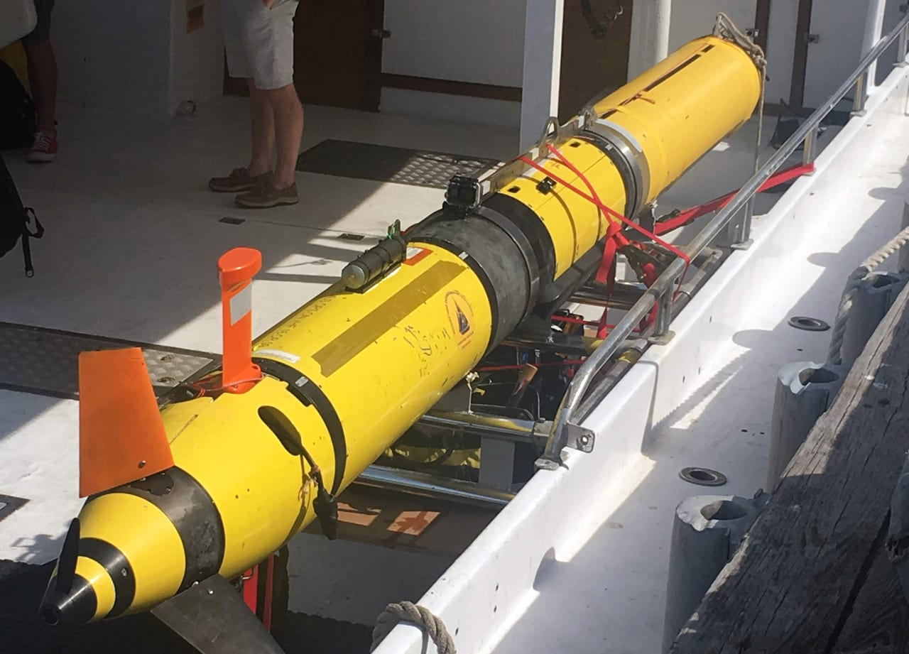 WHOI researchers deployed a REMUS 600 AUV to survey a subsea cable system in Buzzards Bay, Mass. The vehicle uses a propeller and fins for steering and diving, and relies on an internal navigation system to independently survey swaths of the ocean. (Photo by Evan Lubofsky, Woods Hole Oceanographic Institution)