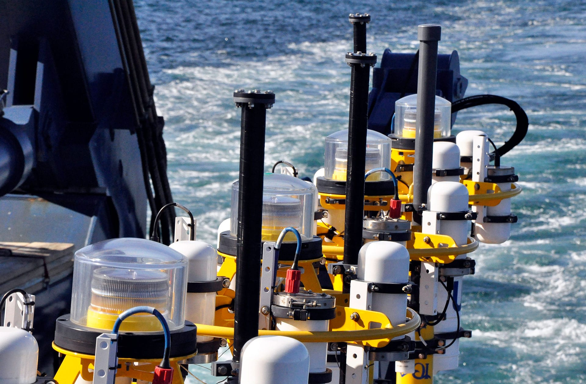 The Pioneer Array includes a variety of instruments that can measure ocean conditions during hurricanes. This includes Coastal Profiler Moorings, which are shown here on the R/V Atlantis prior to deployment. (Photo by John Lund, Woods Hole Oceanographic Institution).