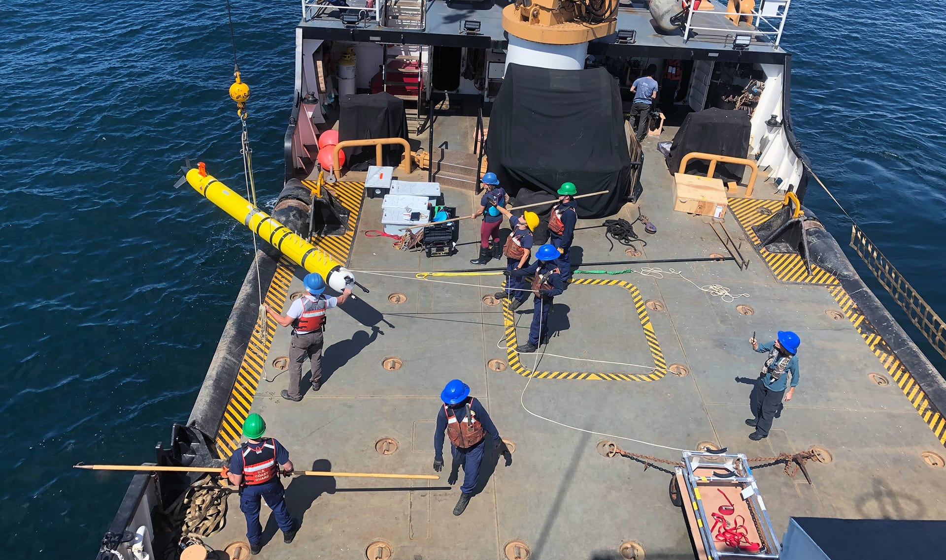An autonomous underwater vehicle (AUV) is launched from the U.S. Coast Guard Cutter (USCGC) George Cobb in Santa Barbara to test the vehicle's oil spill detection capabilities for rapid response during a real-world maritime oil spill. (Photo by Amy Kukulya, Woods Hole Oceanographic Institution)