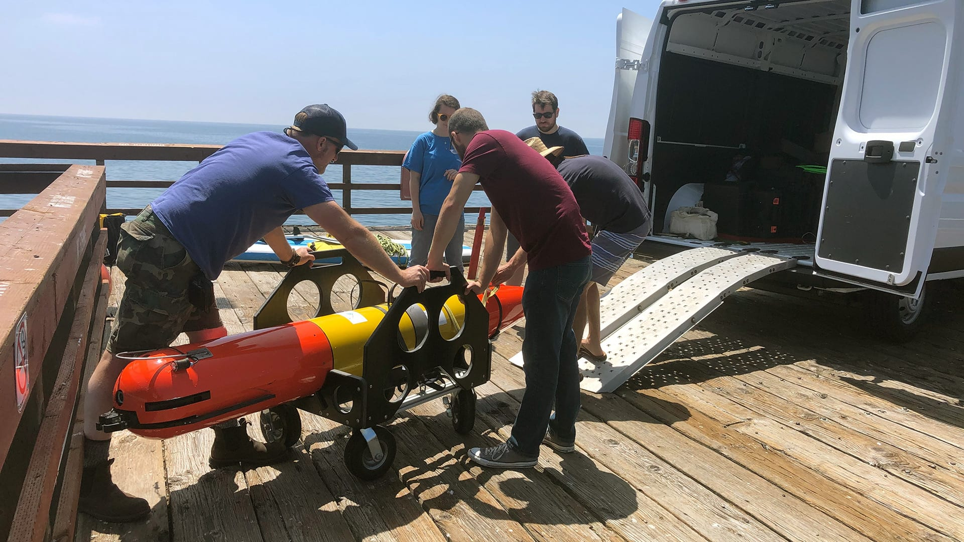 Researchers get the LRAUV ready to deploy for the simulated oil spill response drill. WHOI's strength in marine operations and logistics, combined with the vehicle's small form factor and easy-to-handle design, will enable quick mobilization in the event of an oil spill incident. (Photo by Amy Kukulya, Woods Hole Oceanographic Institution)
