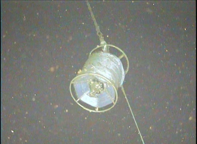 An image of the anchor's recovery pack taken by the <em>Seaeeye Falcon</em>. Typically, this spool is meant to stream a retrieval line to the surface. The image here confirmed the science crew's suspicion that it snagged on ascent. (Photo courtesy of Collin Dobson, Woods Hole Oceanographic Institution).