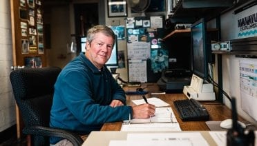 Rick Chandler, one of WHOI's longest-serving employees, oversees support for the Alvin Group. (Photo by Daniel Hentz, Woods Hole Oceanographic Institution)