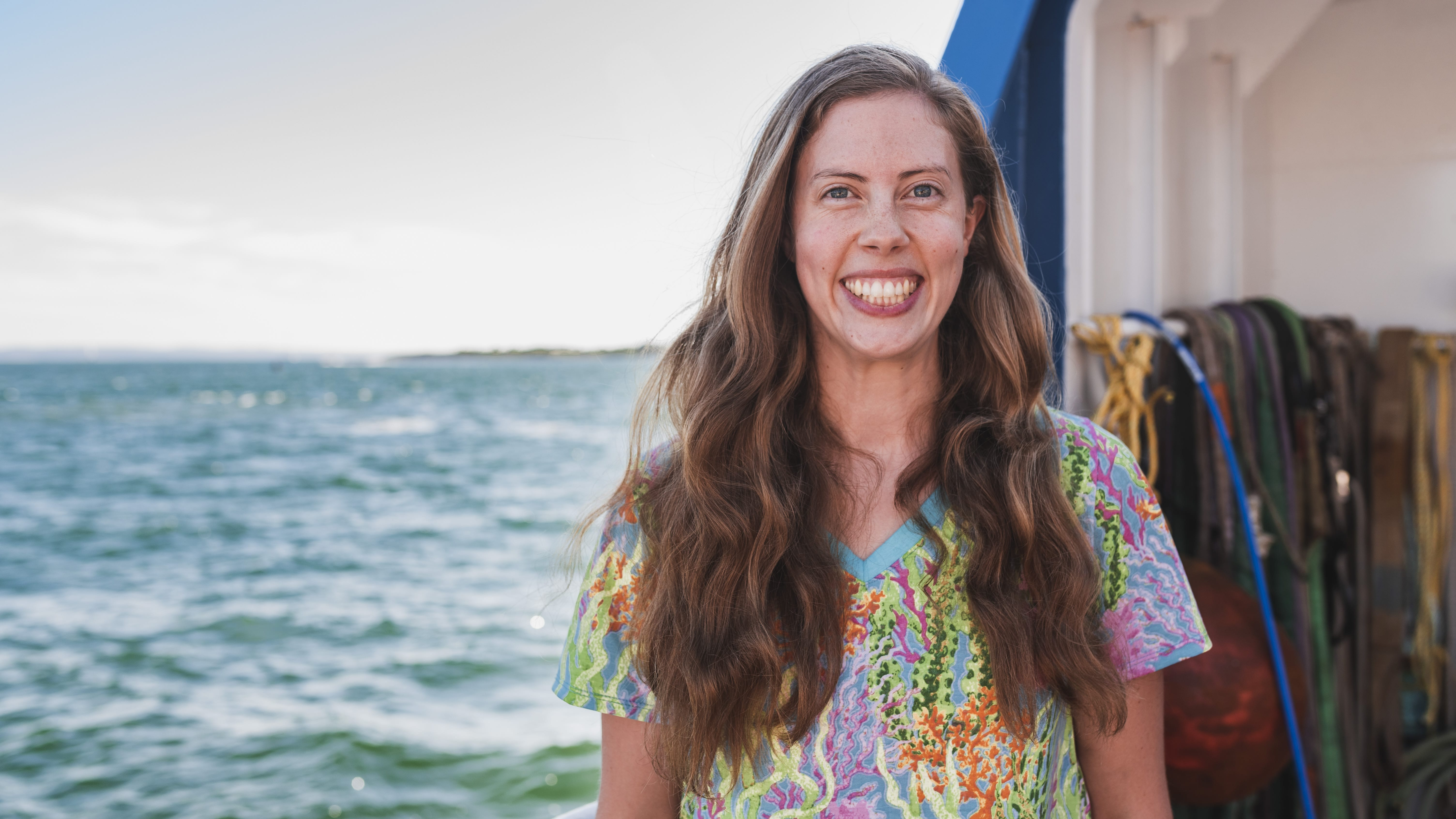 Kirstin Meyer-Kaiser poses for a quick photo before taking off on the R/V Connecticut to run several observations along Stellwagen Bank off the coast of Massachusetts. (Photo by Daniel Hentz | Woods Hole Oceanographic Institution)