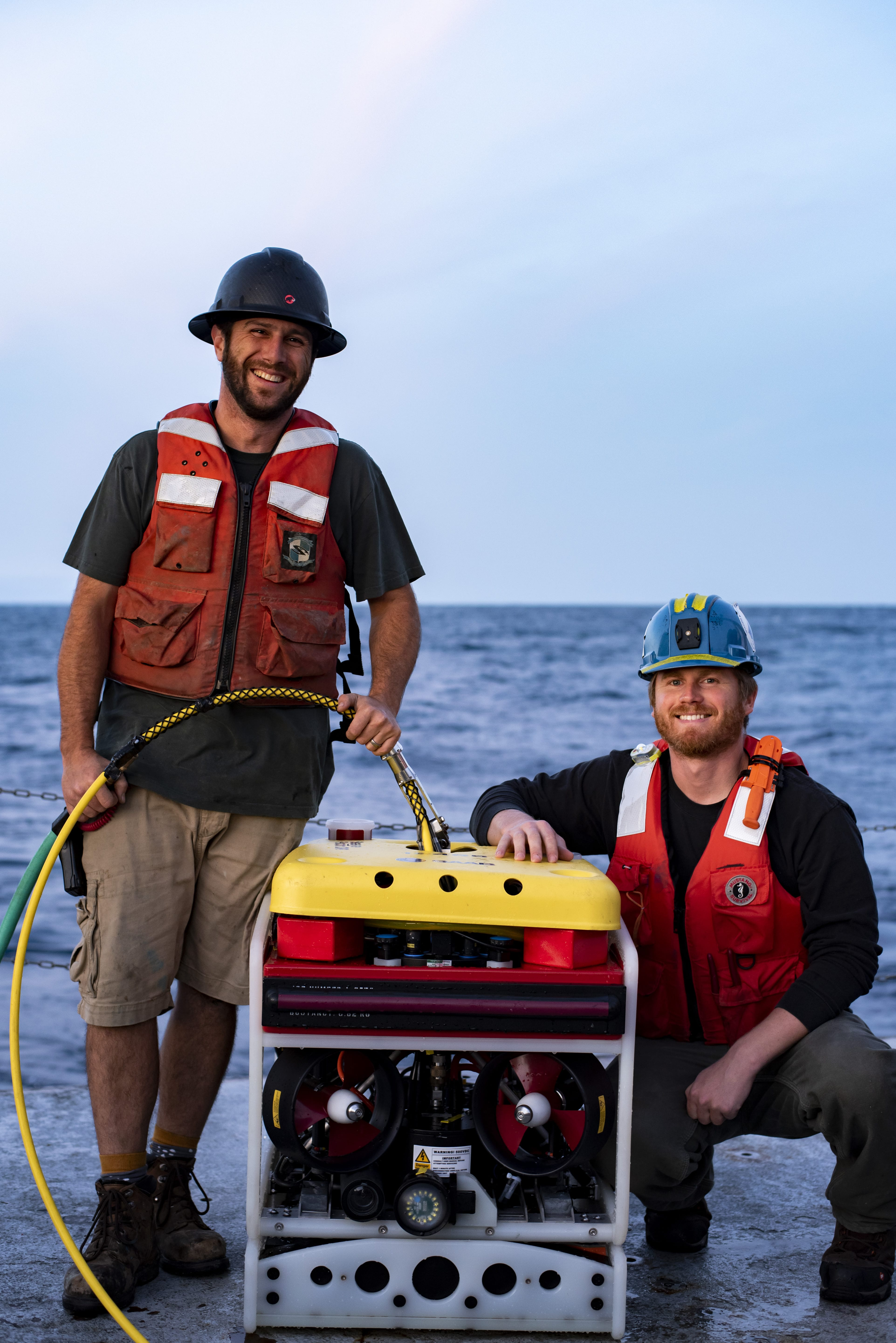 Senior Engineer Jeffrey Pietro (left) and Second Engineer Jared Schwartz (right) pose with the Saab <em>Seaeye Falcon</em> after it successfully located an unrecovered mooring anchor (Photo by Daniel Hentz | Woods Hole Oceanographic Institution)