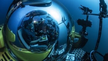 WHOI deep-sea biologist Taylor Heyl (in foreground) explores Lydonia Canyon in the OceanX submersible <em>NADIR</em>  during a dive in the Northeast Canyons and Seamounts National Monument. (Photo by Luis Lamar for National Geographic)