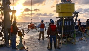 The <i>Neil Armstrong</i> crew begins lowering <i>Orpheus</i> into the Atlantic Ocean for one of the three dives planned for the expedition. (Photo by Emiley Lockhart, Woods Hole Oceanographic Institution)