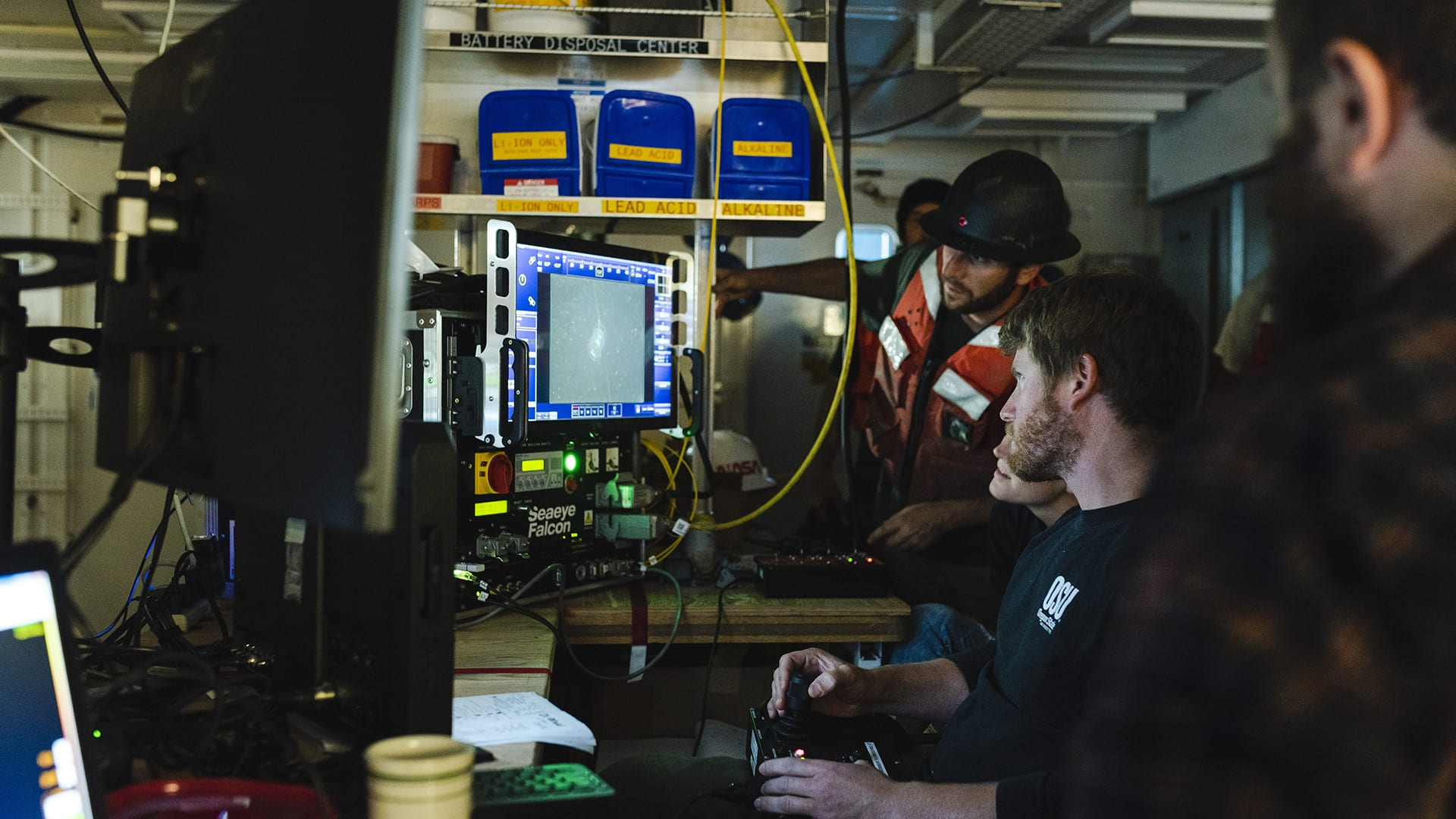 WHOI Engineer Jared Schwartz pilots the remotely operated vehicle, Seaeye Falcon to investigate an unrecovered mooring anchor. (Photo by Daniel Hentz, Woods Hole Oceanographic Institution)