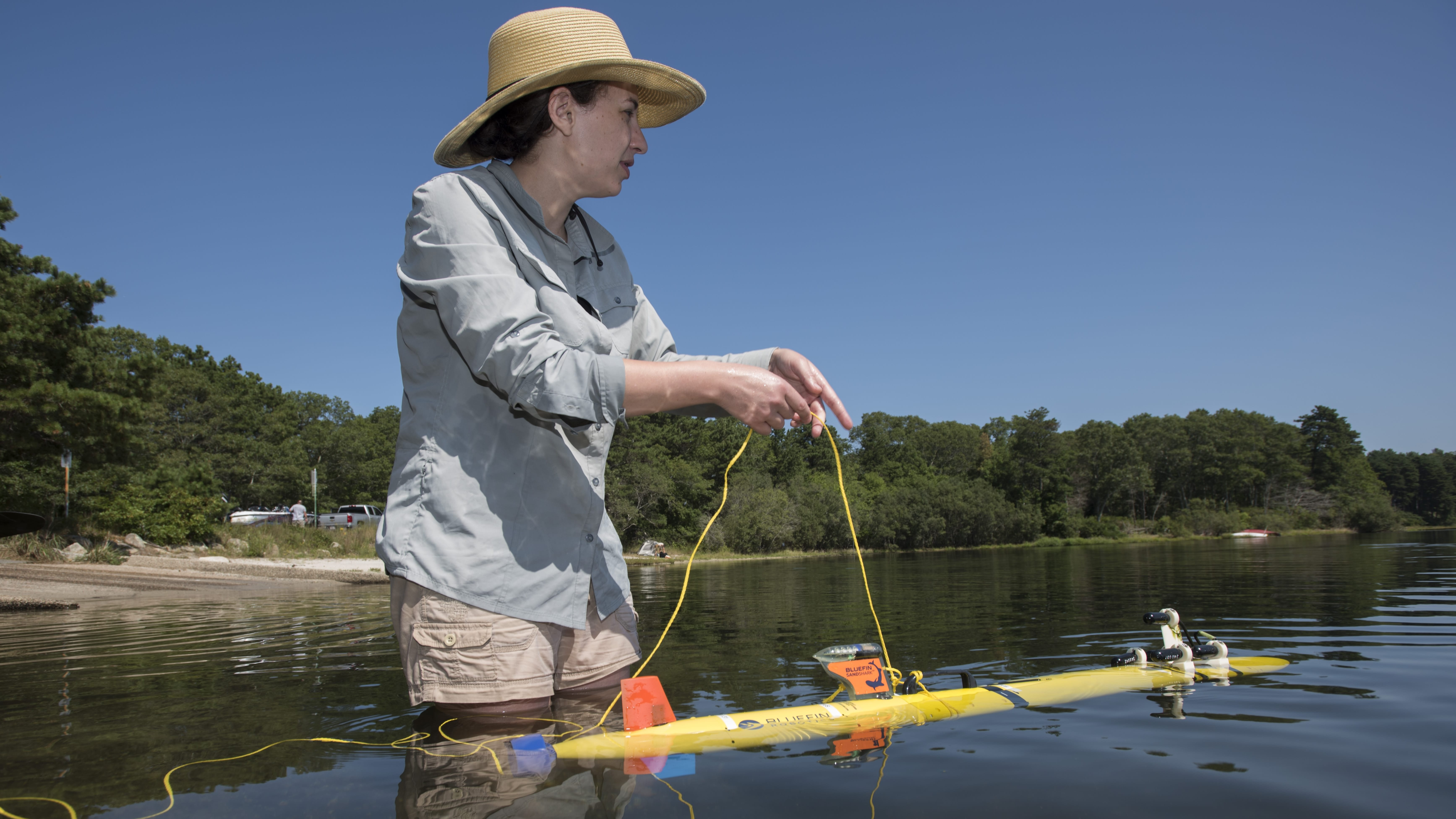 Erin Fischell testing new vehicles at Ashumet Pond on Cape Cod. Photo by Thomas N. Kleindinst | WHOI