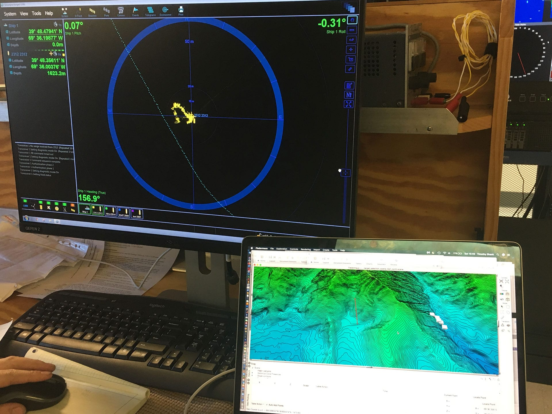 A readout of <em>Orpheus</em>'s location and depth appears on monitors in the <em>Neil Armstrong</em>'s computer lab. (Photo by Tim Shank, Woods Hole Oceanographic Institution)