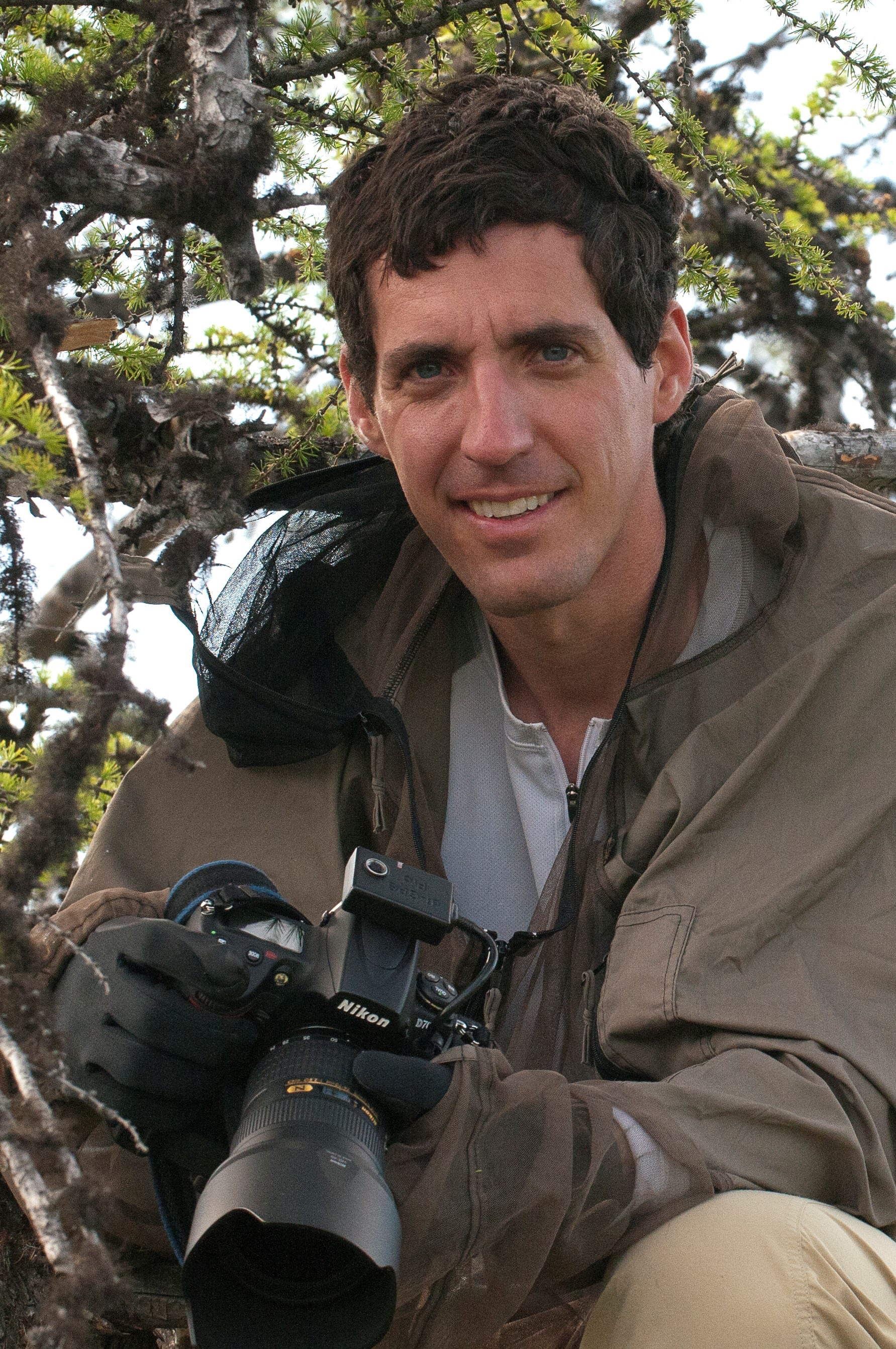 Chris Linder poses for a photo while on assignment in Siberia photographing for his latest book, The Big Thaw. (Photo by Brian Kantor, a student on the Polaris Project)