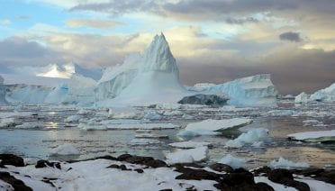 Icebergs move across the Southern Ocean by the Rothera Station in Antarctica. (Photo by Brian Guest, © Woods Hole Oceanographic Institution)