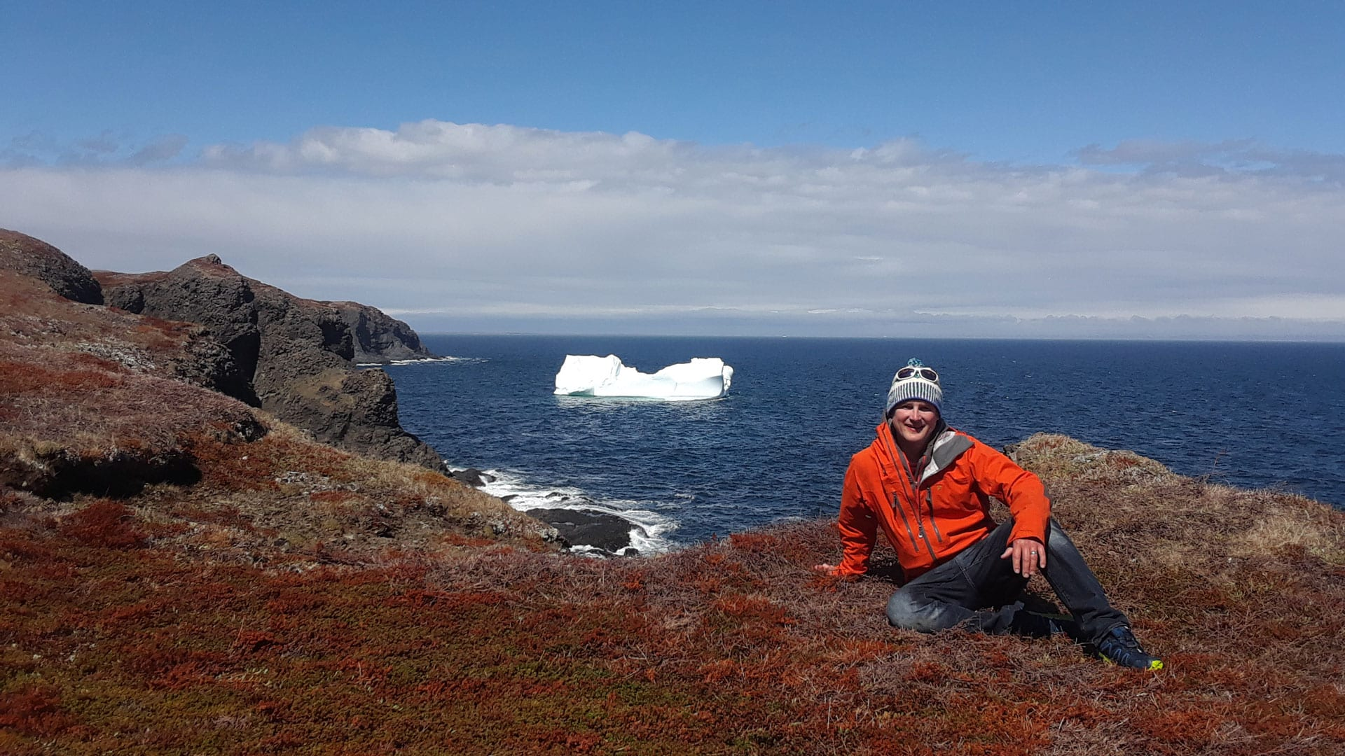 WHOI climate scientist Alan Condron examines an iceberg drifting south in the Labrador Sea. (Photo by Andrew Daly, © Woods Hole Oceanographic Institution)