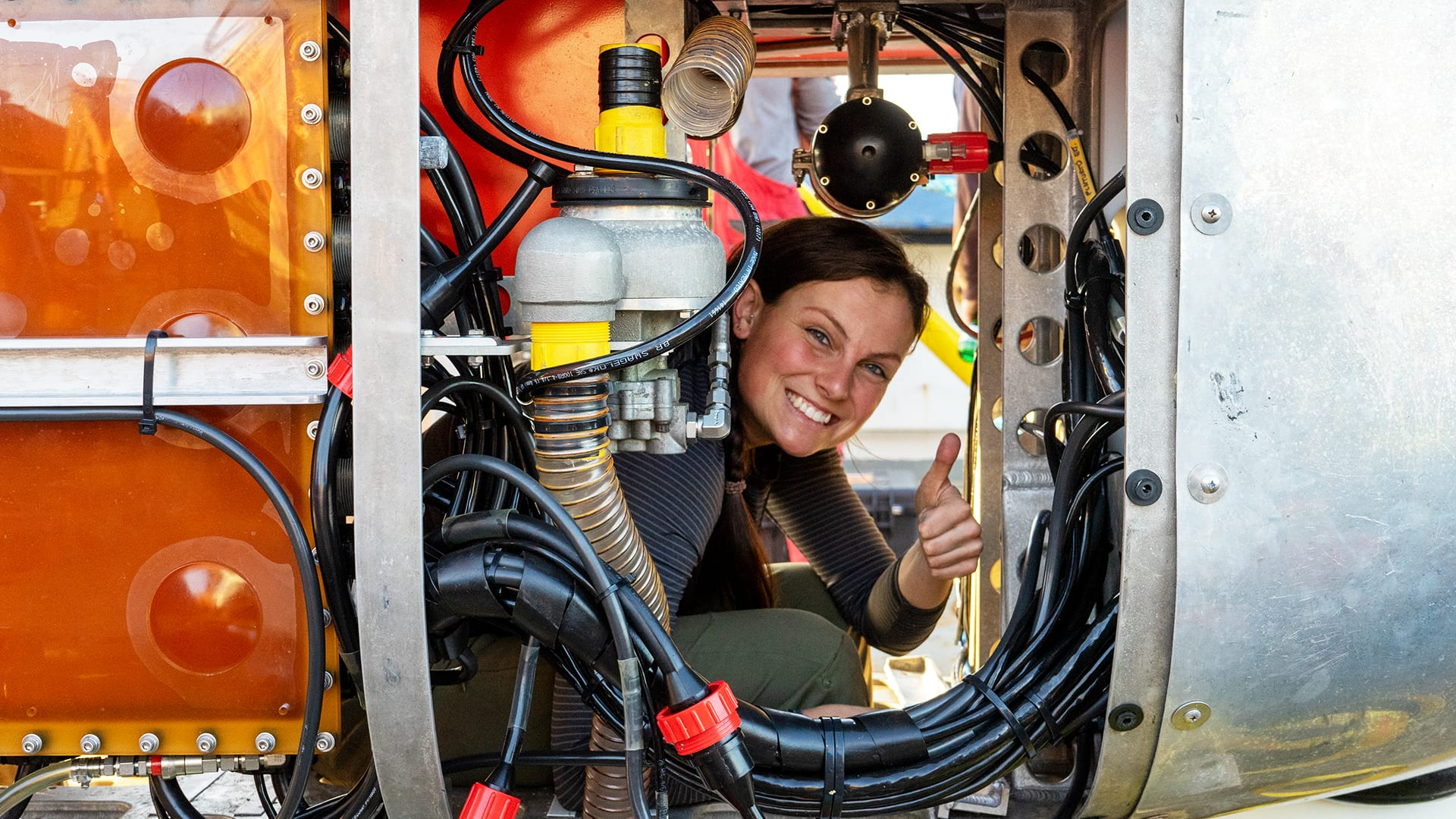 WHOI engineer Molly Curran peers out from <em>Neried Under Ice (NUI)</em>, a hybrid remotely operated vehicle,   which she helped design and operates. (Photo by Mike Toillion, NASA)