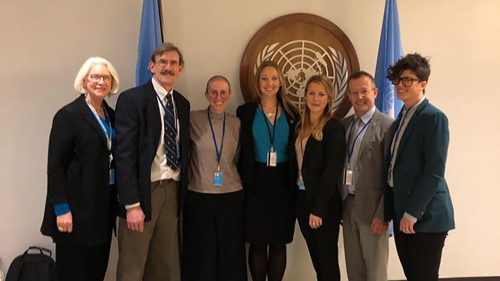Attendees of the Biodiversity Beyond National Jurisdiction second session at the United Nations General Assembly in New York line up for a quick photo. (from left to right) Kristina Gjerde, Porter Hoagland, Aria Ritz Finkelstein, Harriet Harden-Davies, Jane Collins, Torsten Thiele, Muriel Rabone. (© Woods Hole Oceanographic Institution)