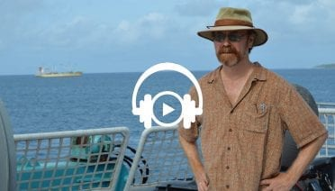 Ken Buesseler on deck as Alucia approaches Majuro (© Woods Hole Oceanographic Institution)