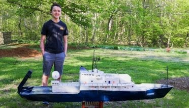Dante Cusolito stands next to his completed radio-controlled model of R/V <em>Atlantis</em>, rendered at 1/34 the size of its real-life counterpart. (Photo courtesy of Dante Cusolito)