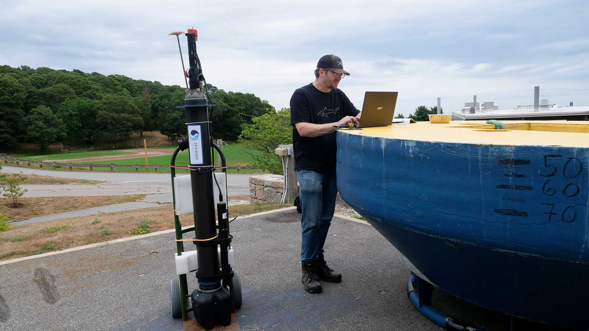 WHOI engineer Bill Dullea with one of the autonomous profiling floats that WHOI will help deploy in the Atlantic Ocean as part of the GO-BGC Array. (Photo by Ken Kostel, ©Woods Hole Oceanographic Institution)