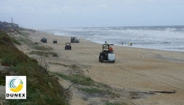 Coastal researchers monitoring the seashore interface along a stretch of beach in North Carolina (Photo by © U.S. Coastal Research Program)