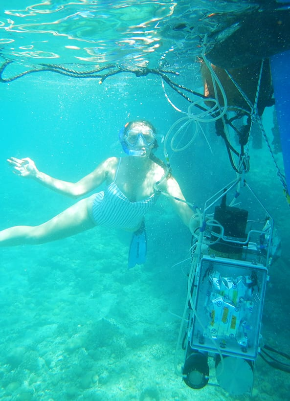 Mallory Ringham hangs on to a suite of sensors, including CHANOS II, in the waters of Eliat, Israel in 2019. (Photo courtesy of collaborator, Boaz Lazar)