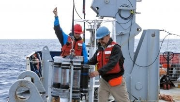 WHOI marine chemist Ken Buesseler (right), one of the authors of the study, deploys a sediment trap used to study the biological carbon pump during a 2018 expedition in the Gulf of Alaska. (Photo by Alyson Santoro, University of California Santa Barbara)