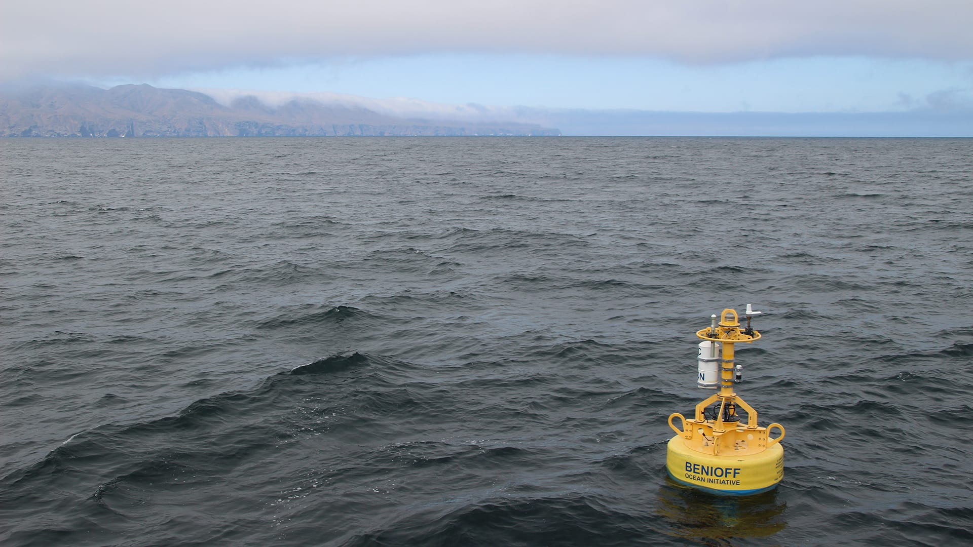 A buoy outfitted with  passive acoustic technology developed by Woods Hole Oceanographic Institution and Texas A&M University at Galveston, floats idly near the shipping lanes of the Santa Barbara Channel in 2019 (Photo courtesy of Morgan Visalli, © Benioff Ocean Initiative)