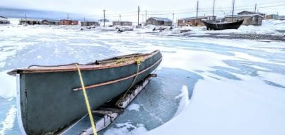 A canoe sits idle in Ulukhaktok, one of several Arctic Inuit communities trying to cope with food insecurity rates that are estimated to be five times the level of food insecurity measured for households in Canada. (Photo by Paul Labn, Oceans North)