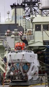 Alvin Pilot and Mechanical Section Leader Danik Forsman securing the crane hook to Alvin while offloading the sub from R/V Atlantis in March.