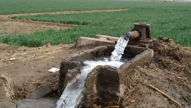 Ancient groundwater flows from a well in the North China plain during a field campaign in 2004 to measure noble gases to reconstruct past temperature. (Photo credit: Werner Aeschbach)