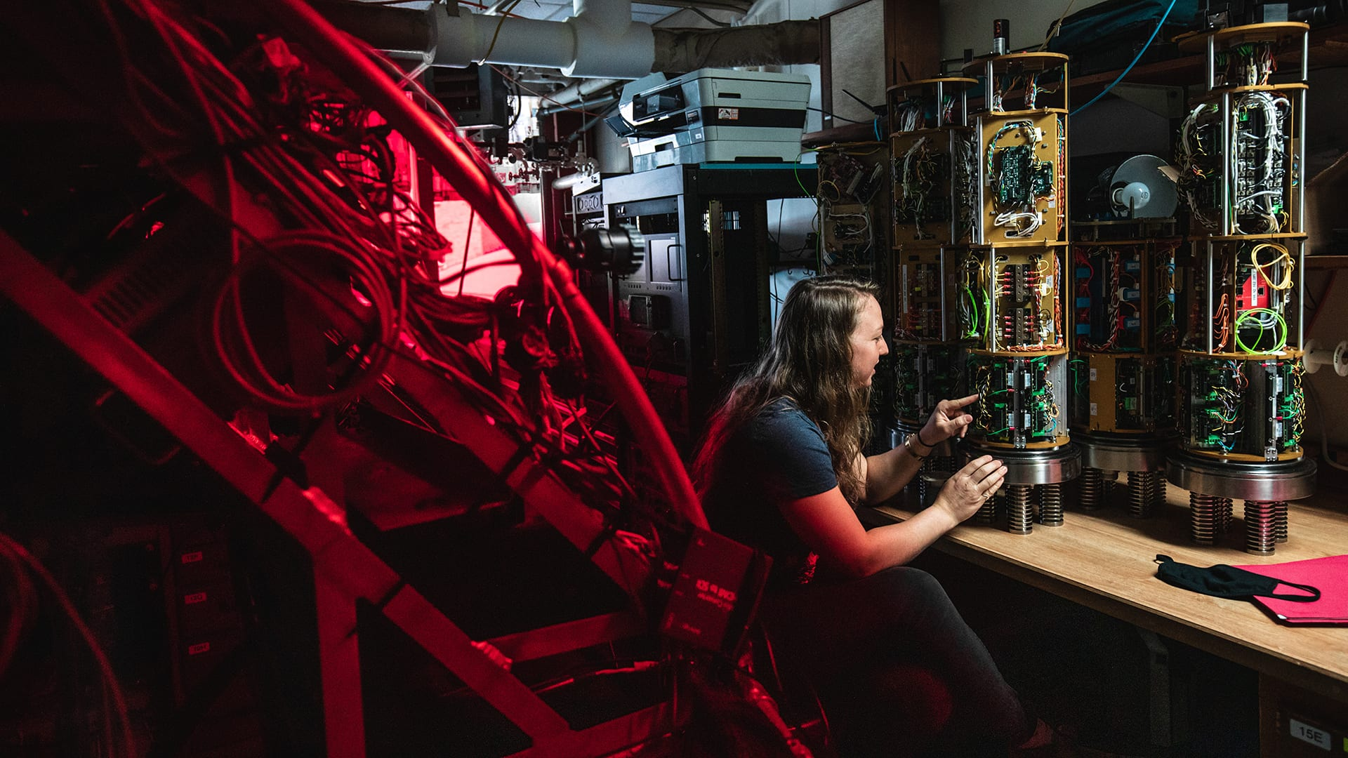 Alvin Group Electrical Engineer Rose Wall working on the power data and imaging chassis that powers and controls the sub's external equipment. (Image Credit: Daniel Hentz © WHOI)