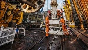 Crew aboard the D/V Chikyu prepare for seafloor drilling