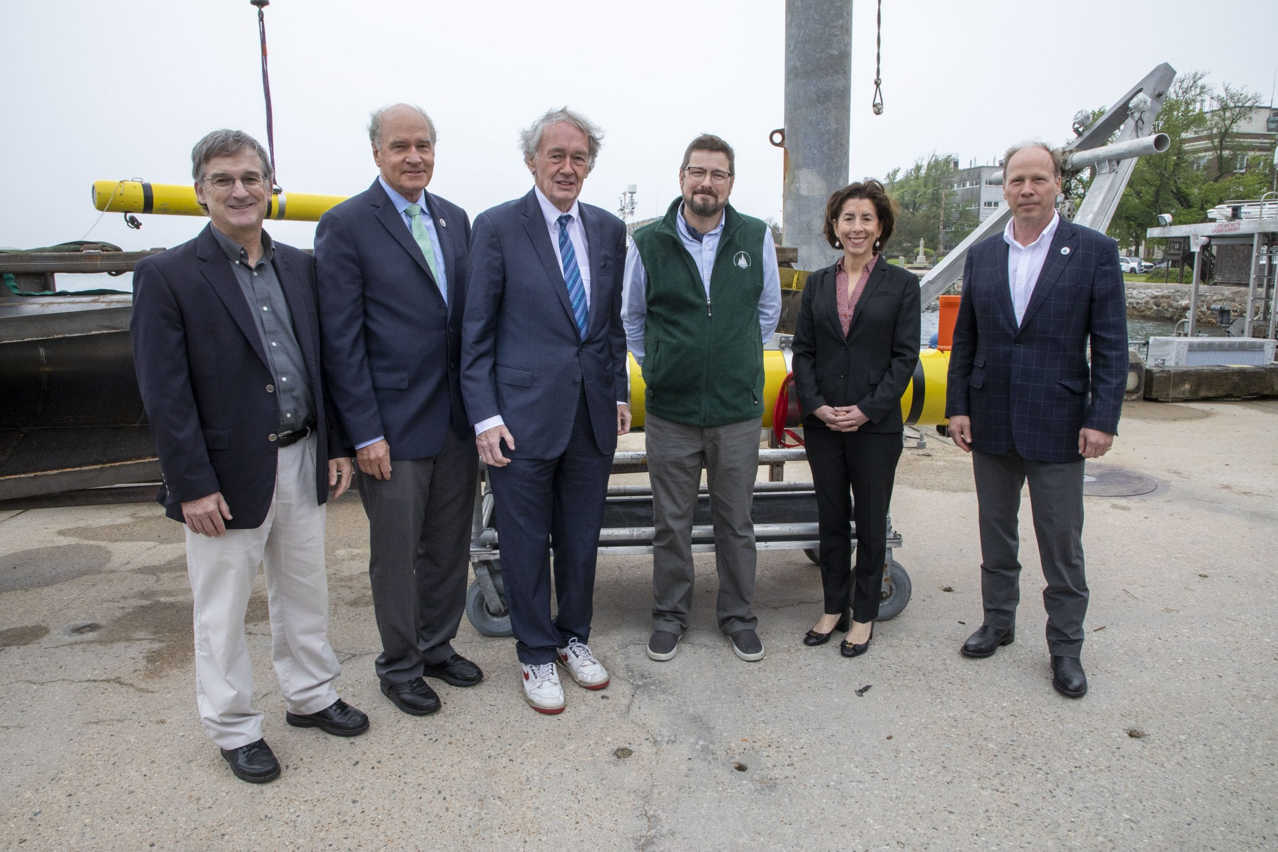 (From left to right): WHOI Deputy Director and Vice President for Science and Engineering Rick Murray, Mass. Congressman William Keating, Mass. Senator Edward Markey, WHOI's Carl Hartsfield, U.S. Commerce Secretary Gina Raimondo and WHOI President and Director Peter de Menocal. (Photo by Jayne Doucette, © Woods Hole Oceanographic Institution)