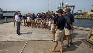 WHOI President & Director Peter de Menocal meets with U.S. Naval Academy midshipmen on WHOI's Dyer's Dock.  Image Credit: Jayne Doucette © Woods Hole Oceanographic Institution