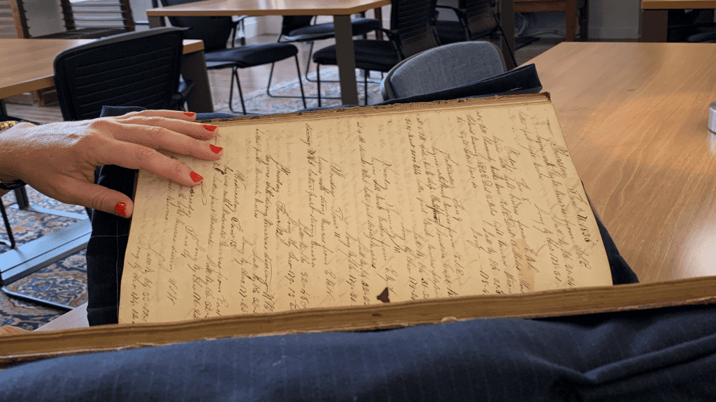 Whaling ship logbooks, like this one, from past centuries contain historical weather data, giving researchers a glimpse of what the climate was like years ago. That data now presents the opportunity to address contemporary questions of climate change. Photo by Jordan Goffin.