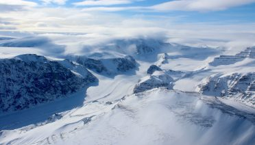 Ice capped and snow-covered mountains of coastal west Greenland. (Apr. 2015) Image credit: Matthew Osman © Woods Hole Oceanographic Institution